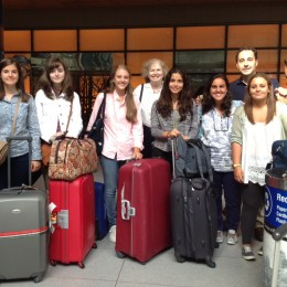 Ms. Rich and the students from Sansuena meet in the Boston airport on their arrival.