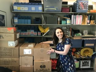 A very excited Ms Donohue poses with the boxes and boxes filled with books for the 2018 Dana Book fair.