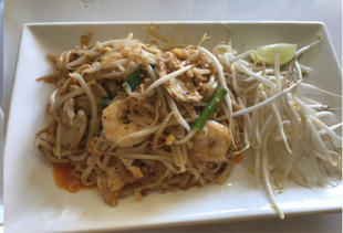 Thai girl eats Pad Thai at Lemon Thai